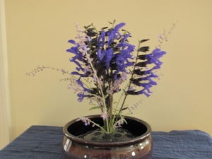 Add Perovskia atriplicifolia (Russian Sage) to help define outer edge of design
