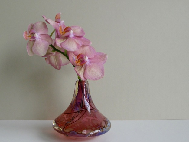 Pink Phalaenopsis And Bottle
